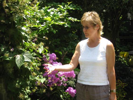 Lorraine Flanigan in her July garden